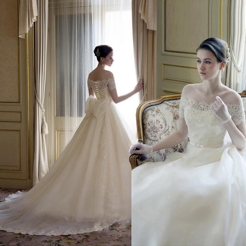 Ball Gown Wedding Dresses With Short Sleeves : Stunning bateau neck wedding dresses with bow sheer