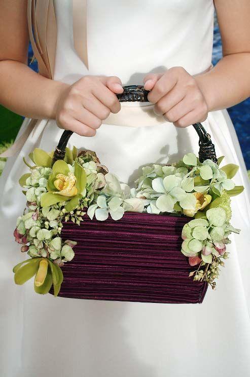 Hochzeit - Green Cymbidium Orchids And Hydrangeas Decorate This Purple Flower Girl Basket, Full Of Light Hydrangea Petals.