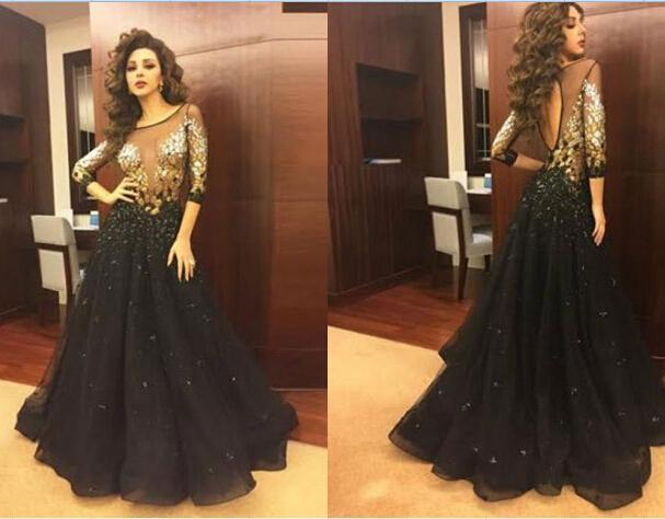 9ed69f15465 2016 Elegant Black Arabic Myriam Fares Evening Party Dresses Half Sleeves  Plus Size Sheer Scoop Prom A Line Crystal Sequins Ball Gowns Online with ...