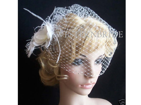 Mariage - Wedding Ivory Bridal Weding Rusian Net Birdcage Veil with double Crystal Edge and fascinator. Ready to wear.
