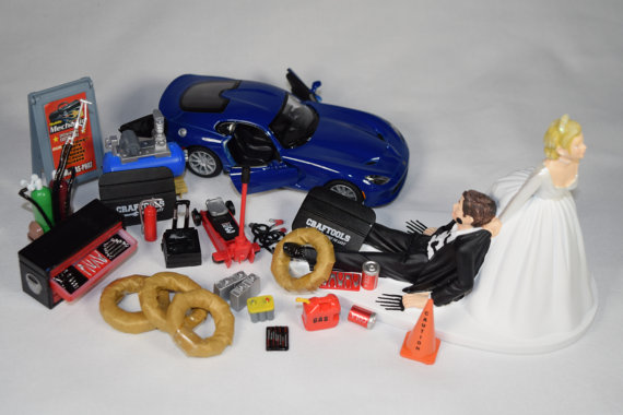 auto mechanic car loving groom being dragged by