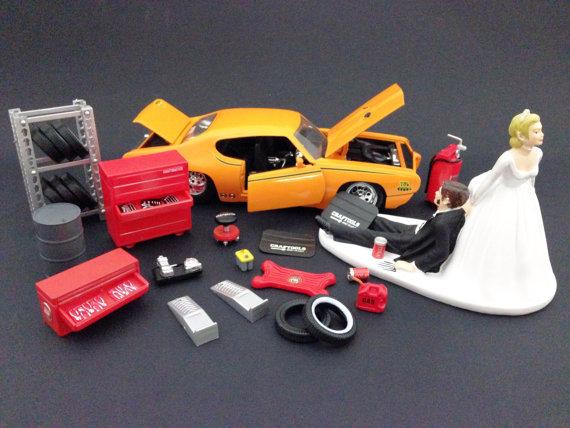 زفاف - Funny Auto Mechanic Car Loving Groom Being Dragged by Bride Wedding Cake Topper with 1969 Orange Pontiac GTO Judge