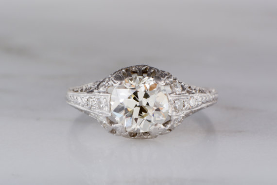 Mariage - 1.30 Carat Early Old European Cut Diamond in Platinum High- Edwardian Mount with Single Cut Diamond Accents R1008