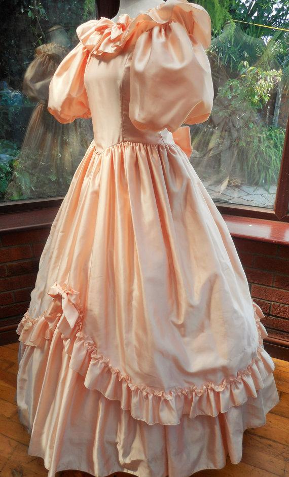 Mariage - Vintage bridesmaids dress peach satin polyester shaped frilled trim with bows and hooped net underskirts   size-uk10 usa size6