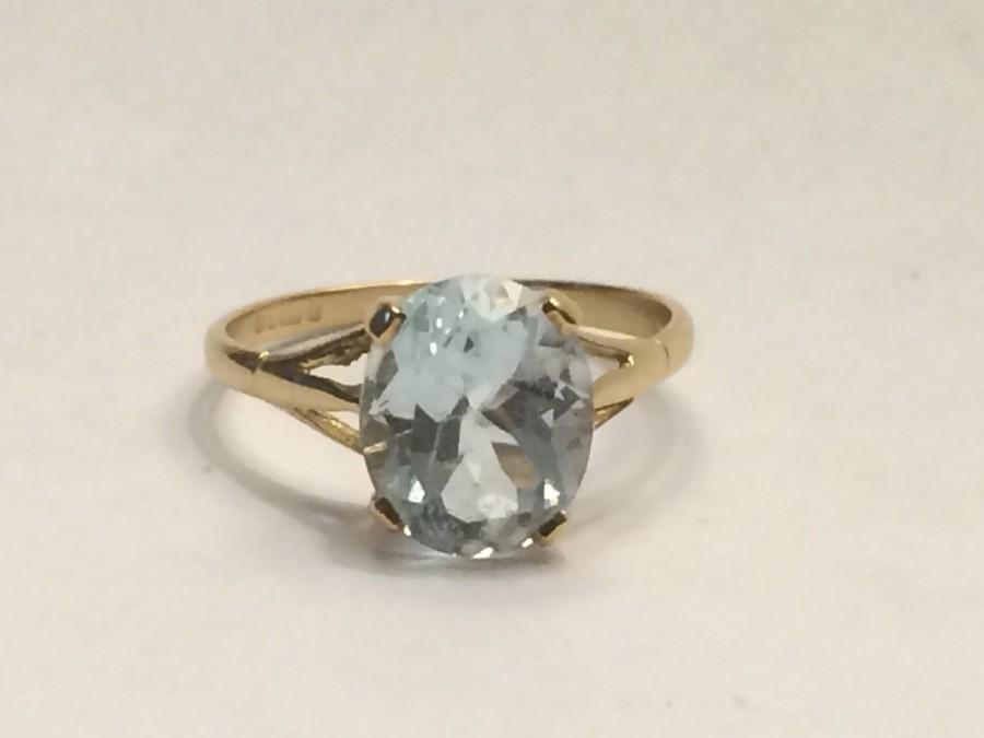 measuring white rings with sky blue oval gold pin set ring topaz x