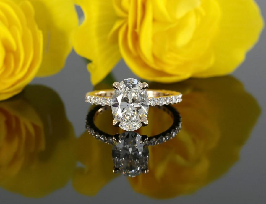 Mariage - 9x7mm Oval Forever Brilliant Moissanite and Diamond Solitaire Engagement Ring in 14k Rose Gold (avail. in white, yellow gold and platinum)