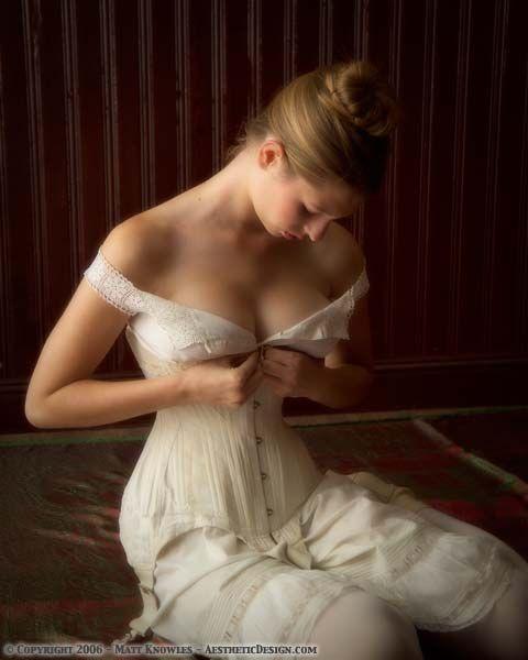 Beautiful Fitness Model Posing In Studio On White Grey
