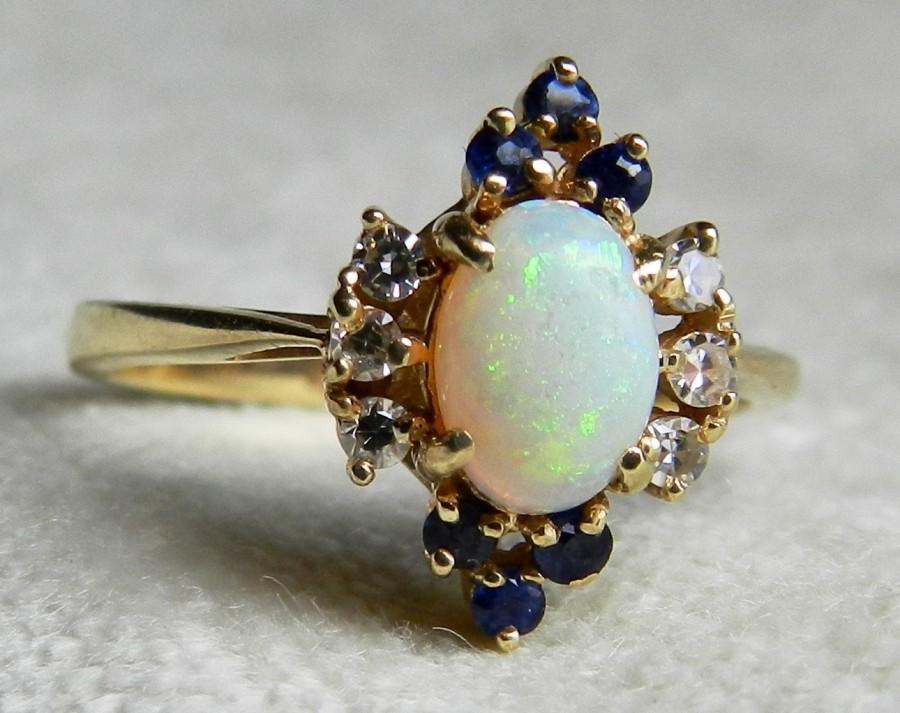 and sapphire opal auctions black australian ring