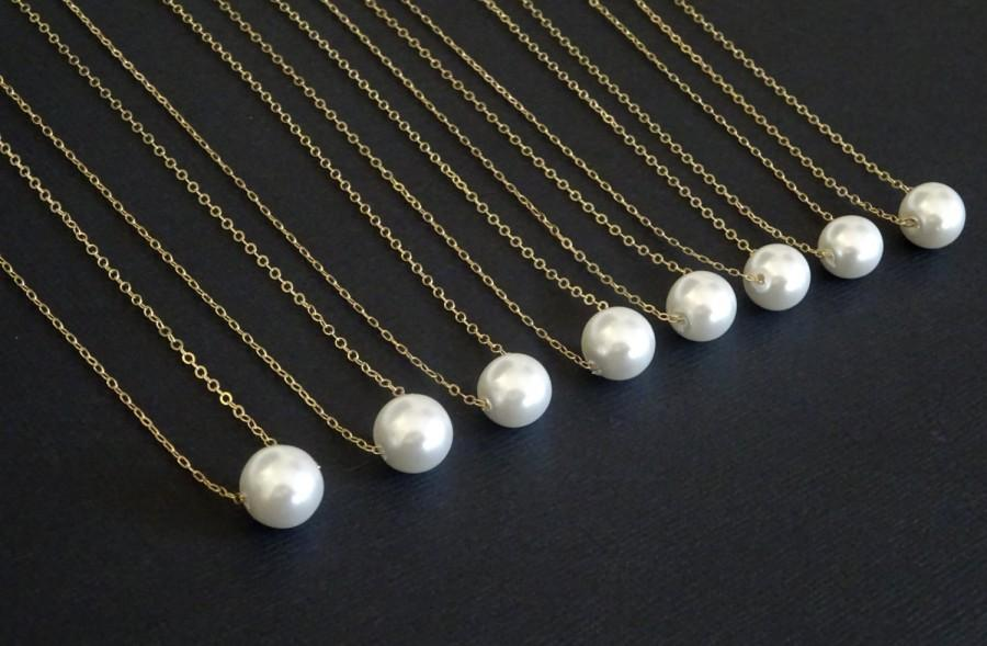 white pearl necklace  ...