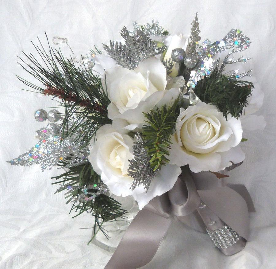 Hochzeit - Winter wedding bouquet and boutonniere white roses silver glitter pine, green pine, and crystal gems winter wedding