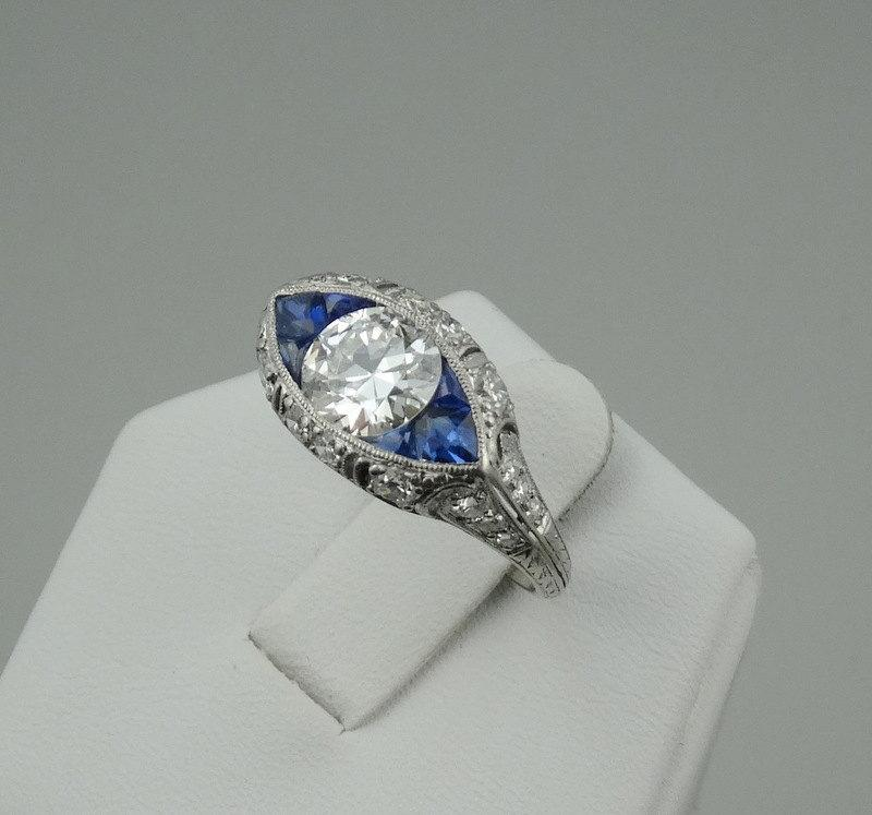 "زفاف - Rare Vintage Victorian Platinum Fine 1.1 Carat Diamond and Sapphire ""Eye Shaped"" Filigree Ring."
