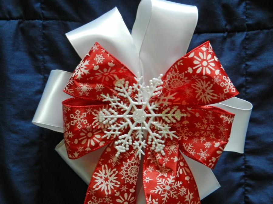 Wedding - Winter Wedding/ pew bow/ Holiday DecorationRed and white snowflake bow set on white satin with snowflake center