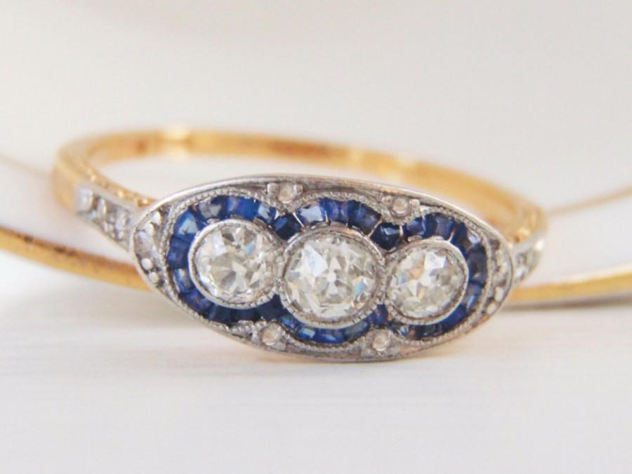 Mariage - Fabulous Art Deco Vintage Engagement Ring. 3 Old European Diamonds with Baguette Sapphire Halo and Ornate Shoulder Engraving. Ring Heaven!