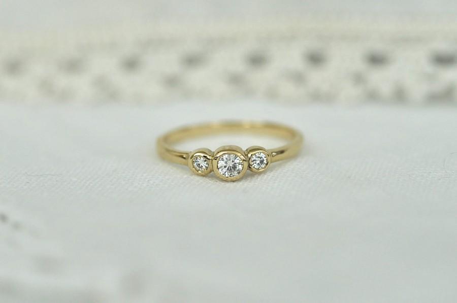 Свадьба - Petite Three Moissanite Ring in Gold