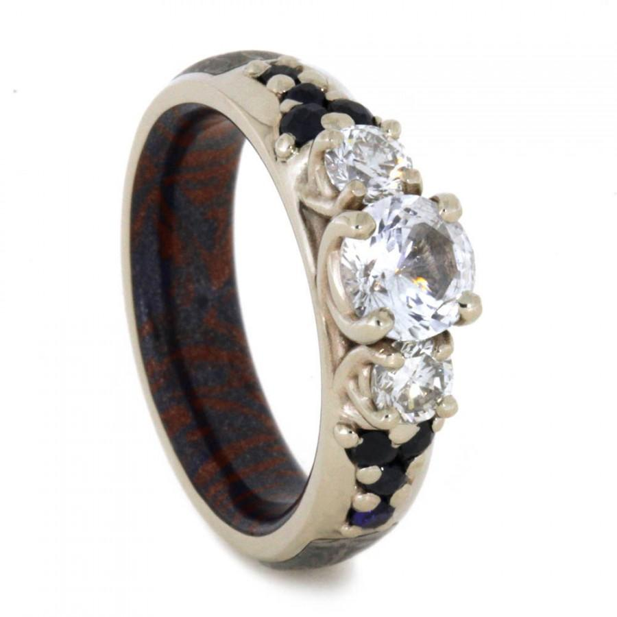 this is a ring made from dinosaur bone meteorite meteorite wedding ring