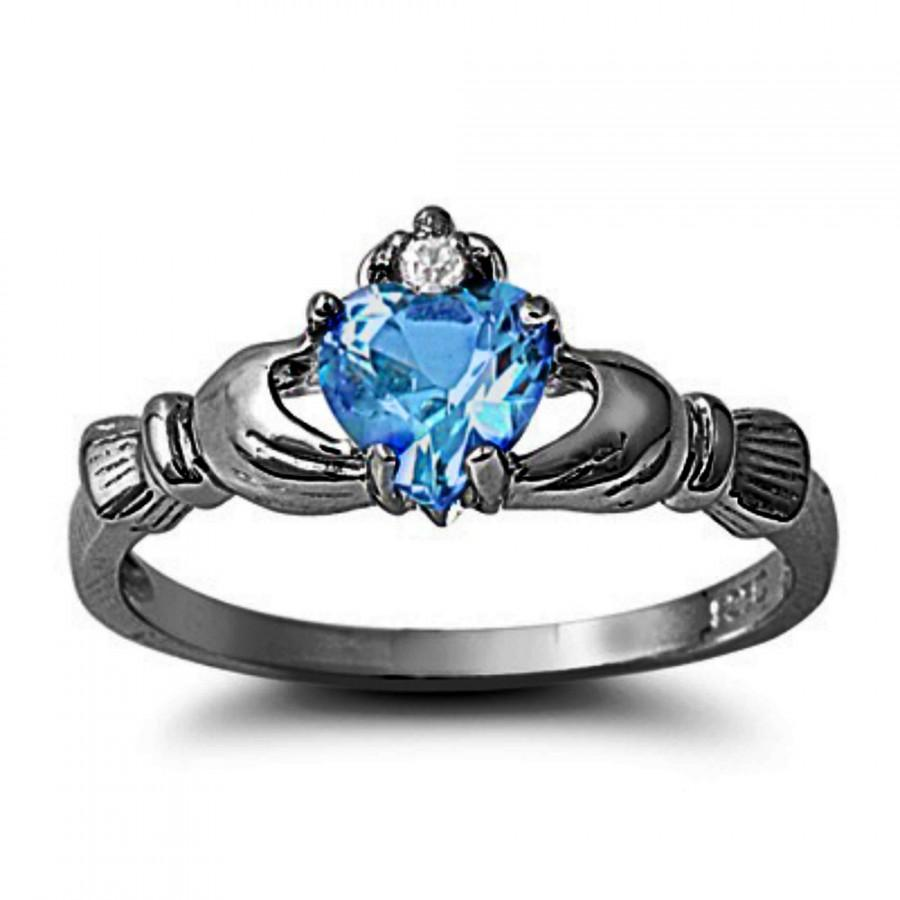 Blue Topaz Claddagh Ring