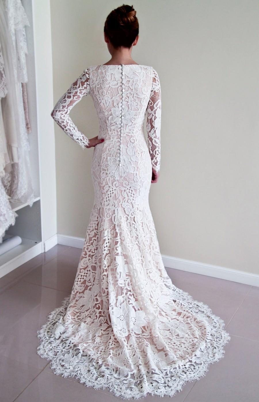 Lace Wedding Dress With Covered Back And Long Sleeves Made Of