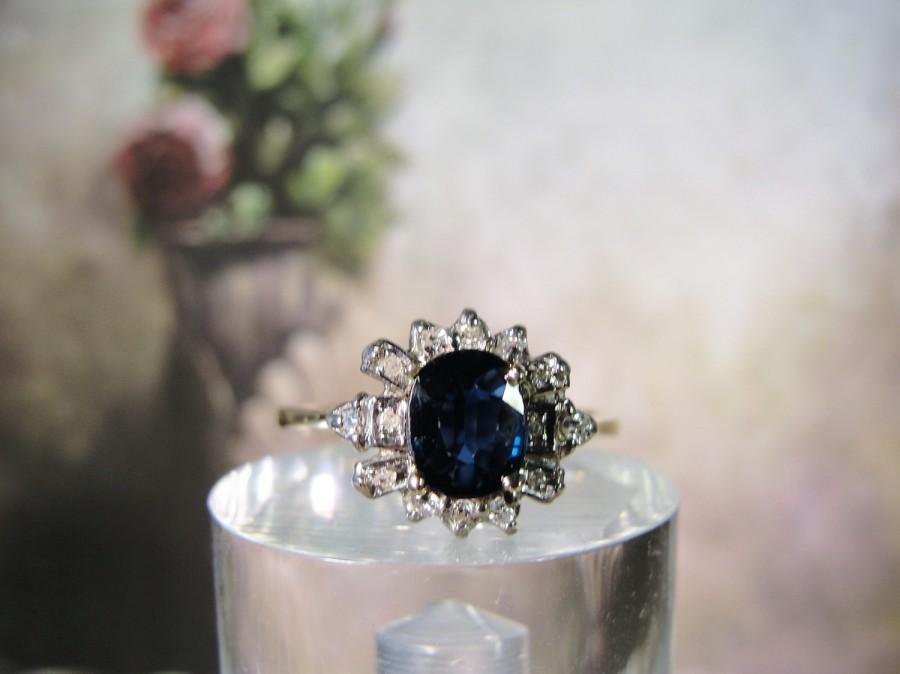 Mariage - 1950s Haloed Art Deco Engagement Ring done in 14K Gold Natural Blue Oval Cut Sapphire with 14 Genuine Diamond Accents – Size 6.5