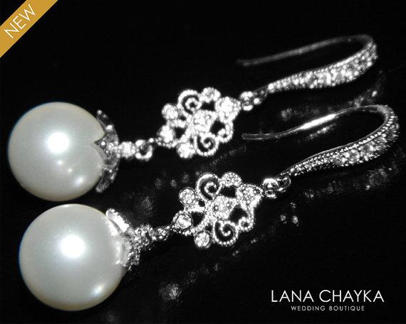 Hochzeit - White Drop Pearl Chandelier Earrings Swarovski 10mm Pearl Dangle Earrings Sterling Silver CZ Pearl Earrings Pearl Bridal Earrings Weddings