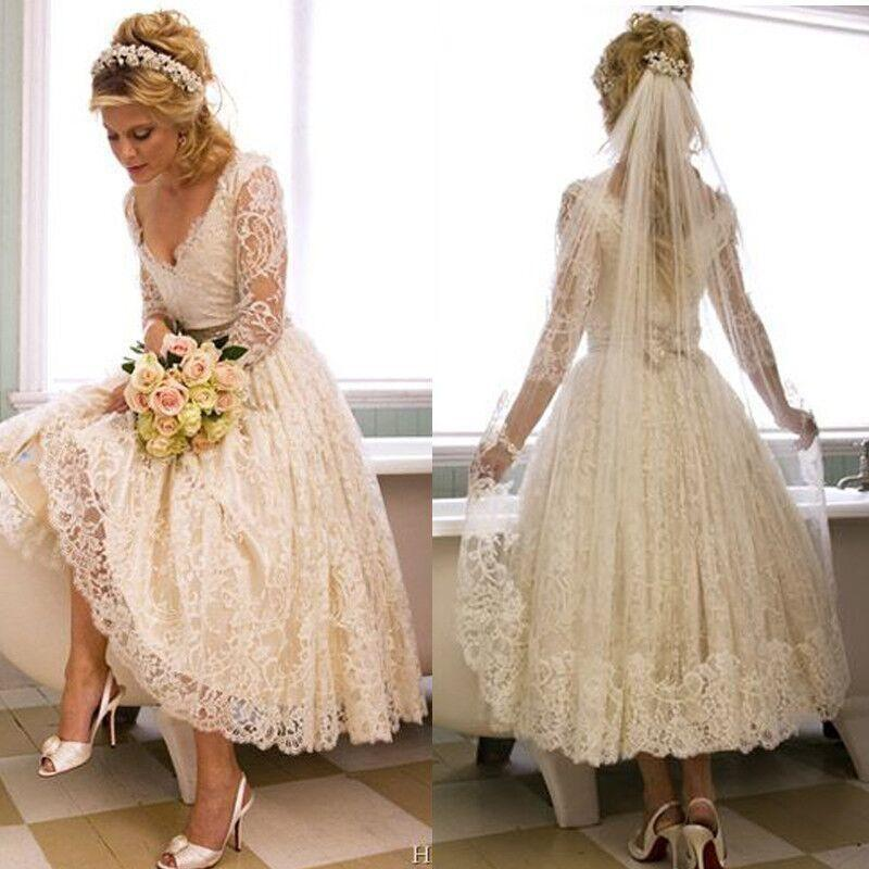 Mariage - Stunning Ivory Garden Short V-Neck Wedding Dresses 2016 Illusion Applique Lace Sheer Tea Length Bridal Ball Gowns Long Sleeve Online with $103.67/Piece on Hjklp88's Store