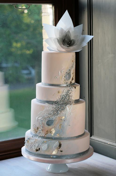 Hochzeit - A Mix Of Pearls, Silver And Gold Gives A Sleek Beige Cake Artistic Flare.
