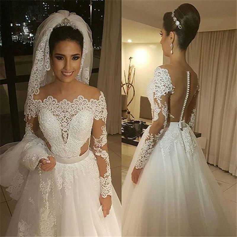 Dramatic long sleeve lace wedding dresses sheer arbic for Long sleeve sheer wedding dresses