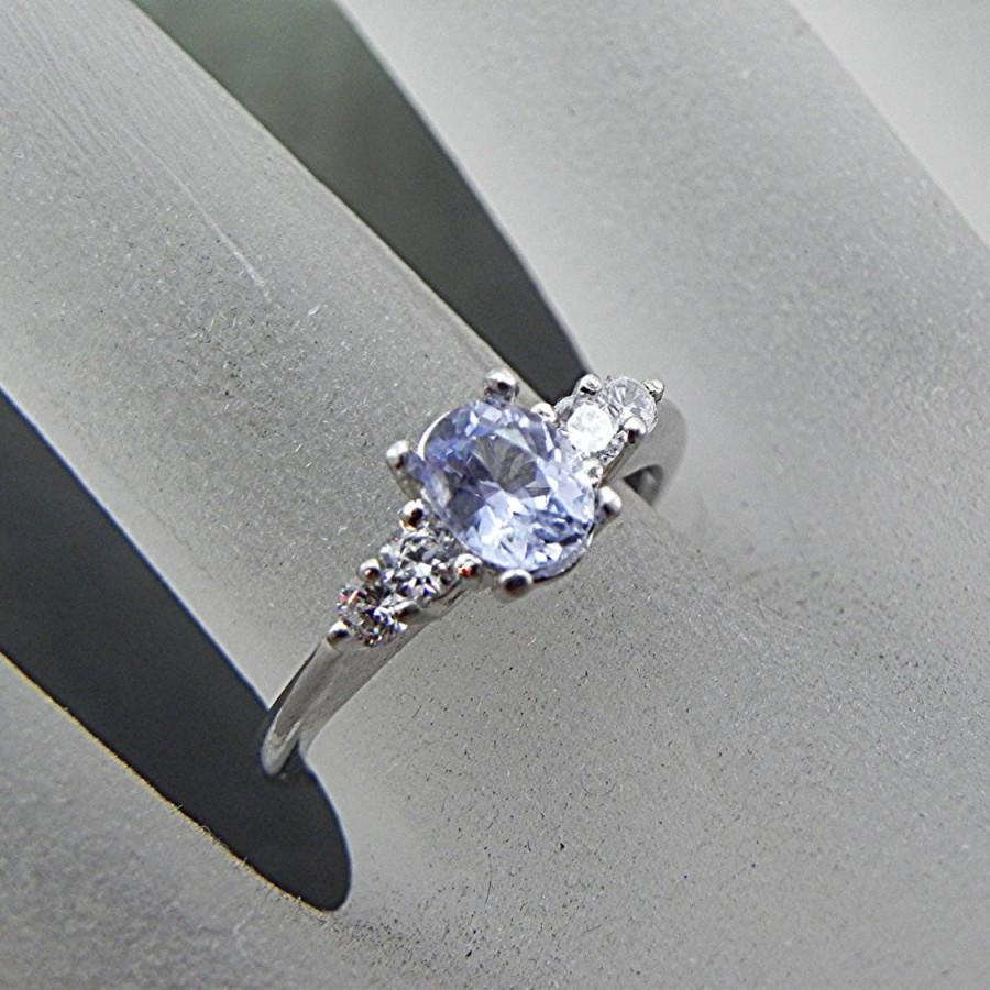 Mariage - Natural Untreated Light Blue Sapphire 6x5mm  .77 carats set in 14K white gold ring with White sapphire accents 0979