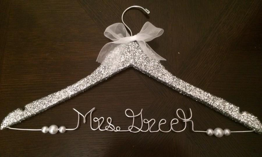 Mariage - Personalized Glitter Bridal or Wedding Hanger with ribbon and pearls! Silver, Gold, or White Iridescent Glitter Available!