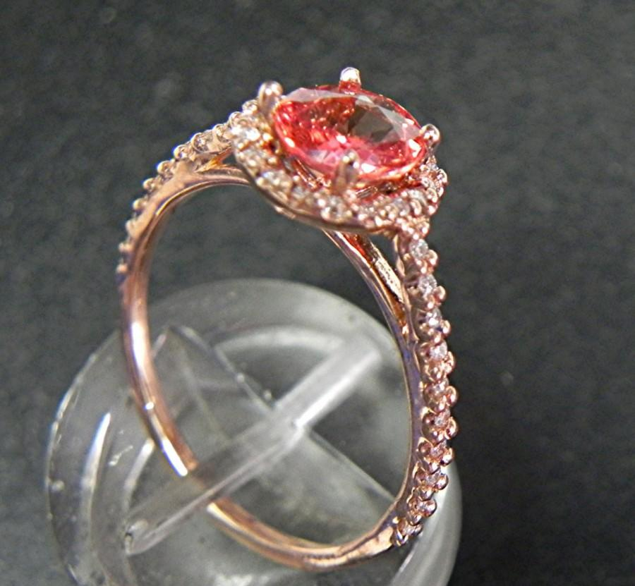 Hochzeit - Orange Pink Padparadschah Sapphire 6mm .78 carats in 14K Rose gold Diamond Halo ring  1161