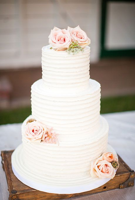 Three tiered white cake with pink flowers 2552732 weddbook three tiered white cake with pink flowers mightylinksfo