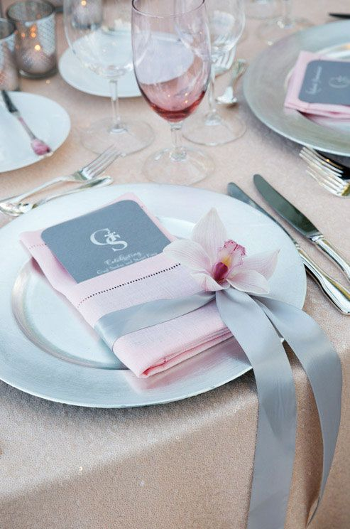 Hochzeit - A Single Pink Cymbidium Orchid Punctuates A Slate Gray Ribbon That Wraps Around A Beautiful Pink Hemstitch Napkin.
