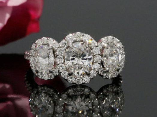 84a00e5366d7df Oval Moissanite Three Stone Halo Engagement Ring with Diamonds in 14K White  Gold. Oval Ring (avail. rose gold, yellow gold and platinum)