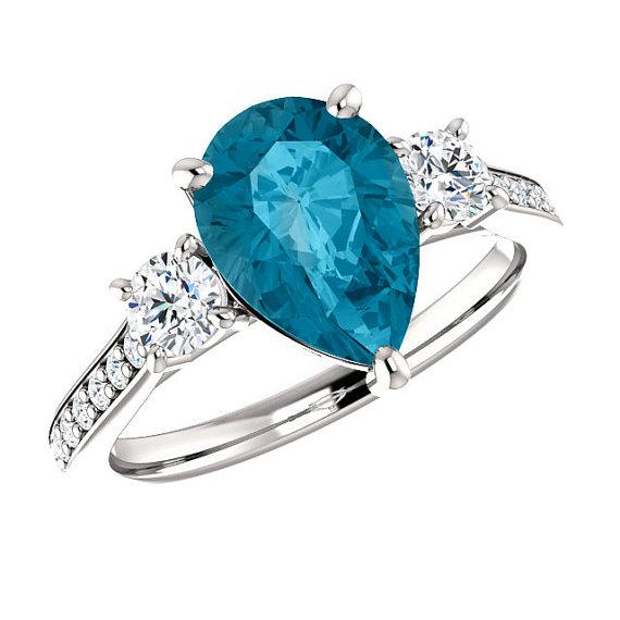 3 50 carat pear london blue topaz diamond three stone platinum