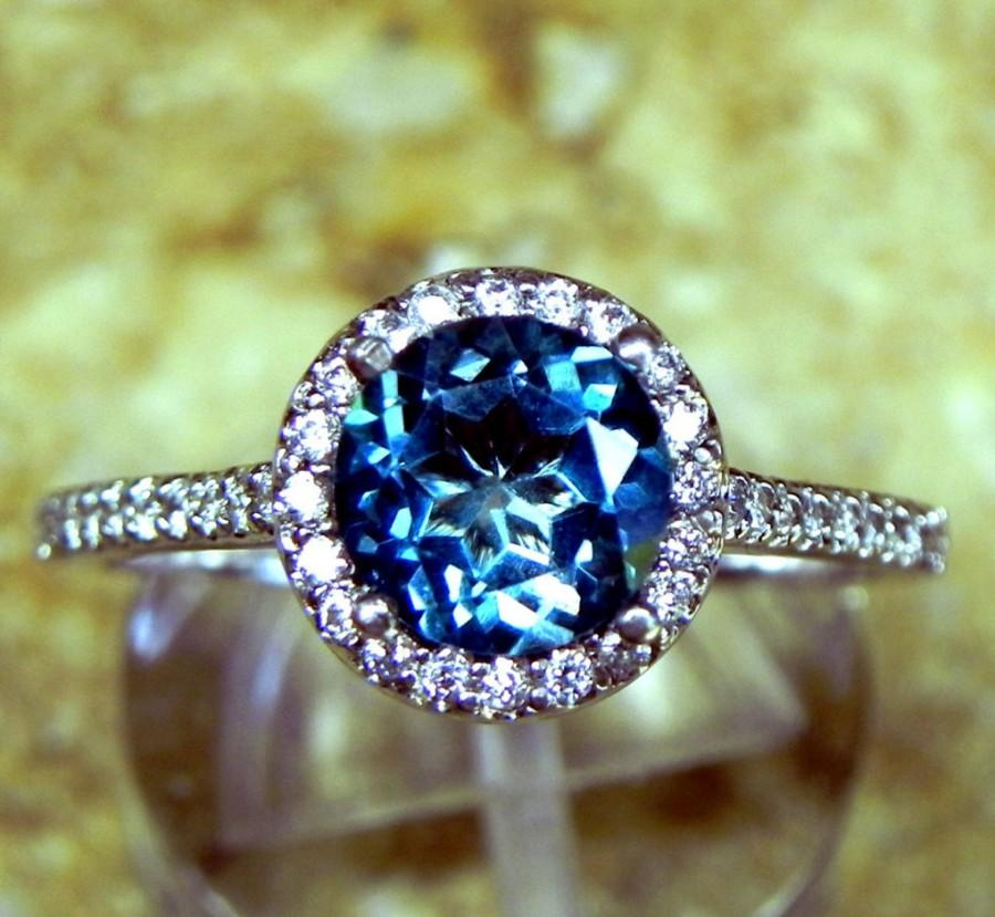 Mariage - AAAA Round Natural London Blue Topaz (1.50ct) 7.00 mm in 14K white gold Halo ring with .30 carats of diamonds