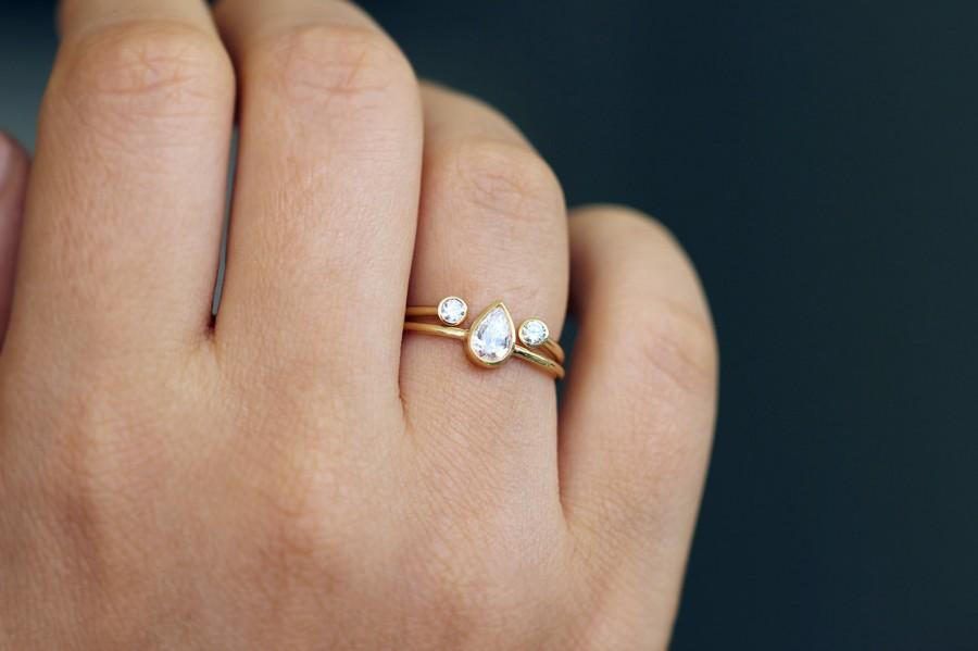 Pear Diamond Ring With A Dual Diamond Horseshoe Ring Wedding Set