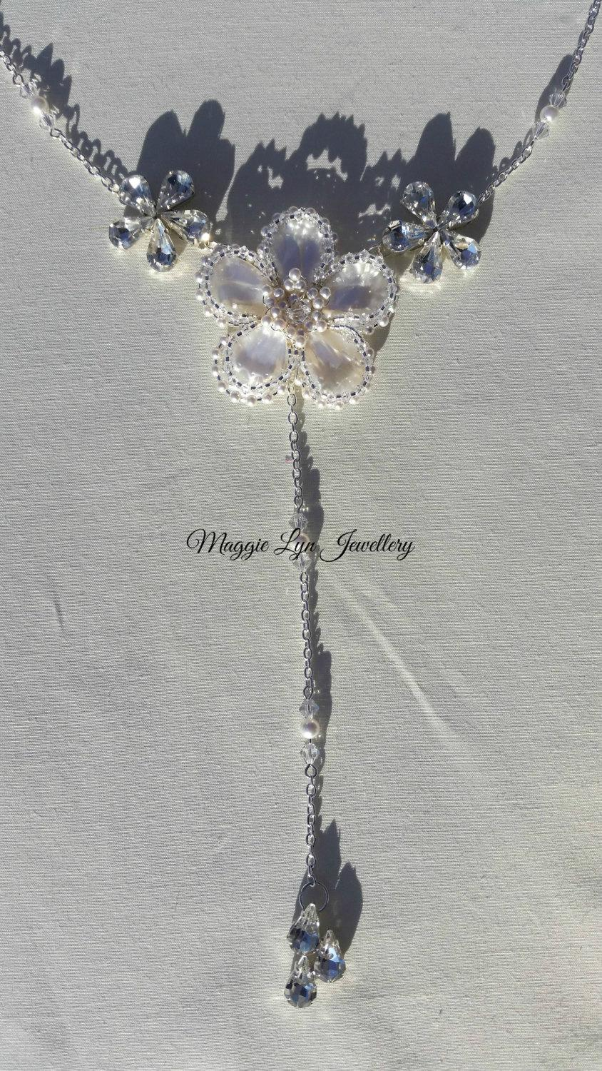 Mariage - Stunning bridal flower backlace necklace, UK handmade with Mother of pearls, Swarovski Crystals and ivory pearls. Matching items available