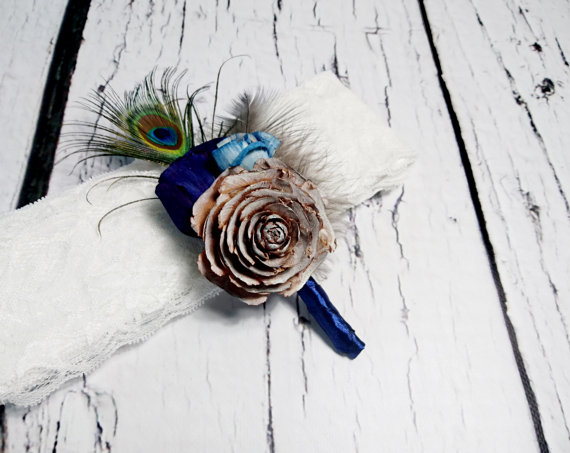 Mariage - BOUTONNIERE / CORSAGE cedar rose dark blue turquoise sola flowers rustic wedding real PEACOCK feathers