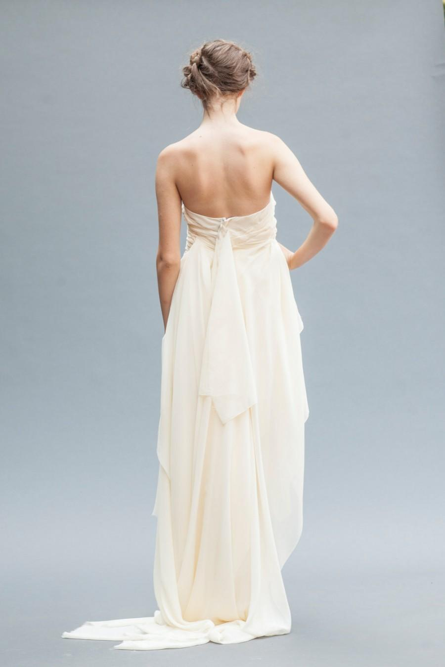 Wedding - Short Wedding Dress. This backless wedding gown features luxurious Grecian draping in silk chiffon, ending in a floor length ruffled train.
