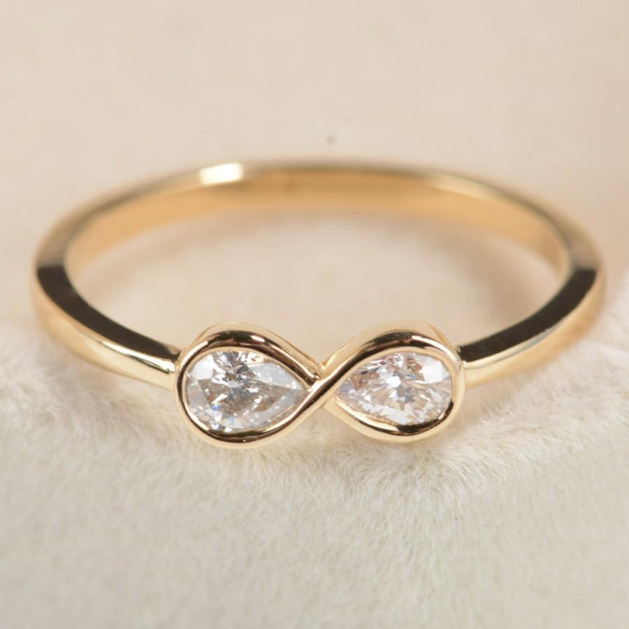 stone with ring diamonds engagement white two pear symbol diamond twist infinity gold