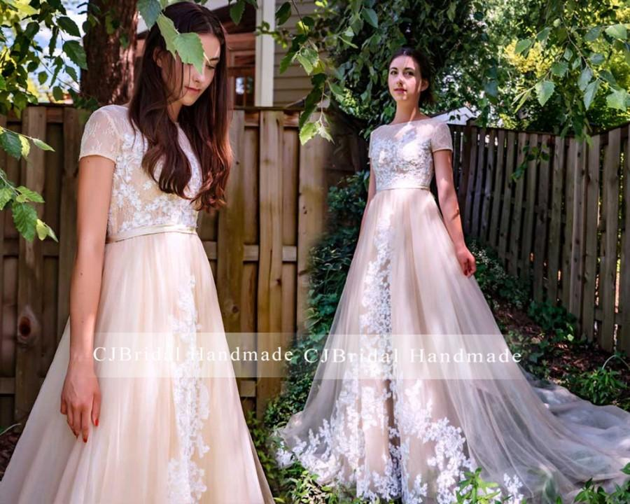 Mariage - Unique  Light Champagne Short Cap Sleeve Lace Appliqué See Through Back with Button A Line Chapel Train Romantic Wedding Dress Bridal Gown