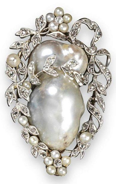 Mariage - An Early 20th Century Pearl And Diamond Brooch. The Baroque Pearl Set Within A S