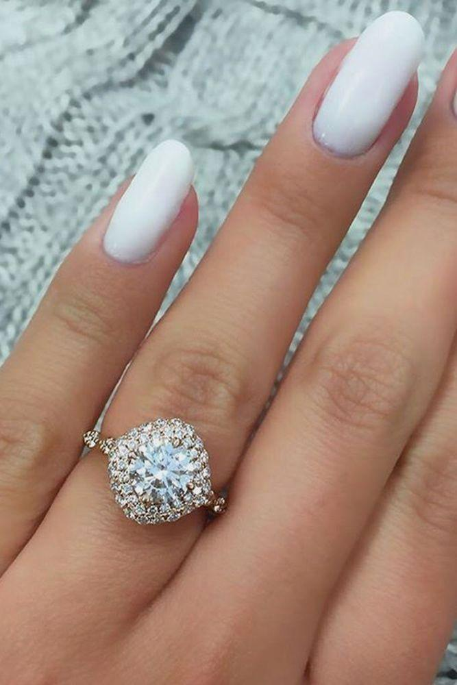 Hochzeit - Unique Engagement Rings That Wow ❤ See More: Http://www.weddingforward.com/unique-engagement-rings/ #weddings #haloengagementring