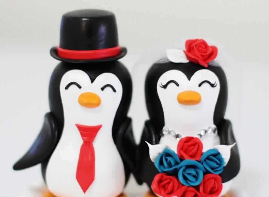 Wedding - A penguin couple wedding cake topper. with red and green roses