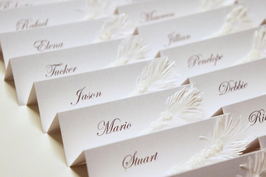 Hochzeit - White Wedding place cards with pearls and feather decor