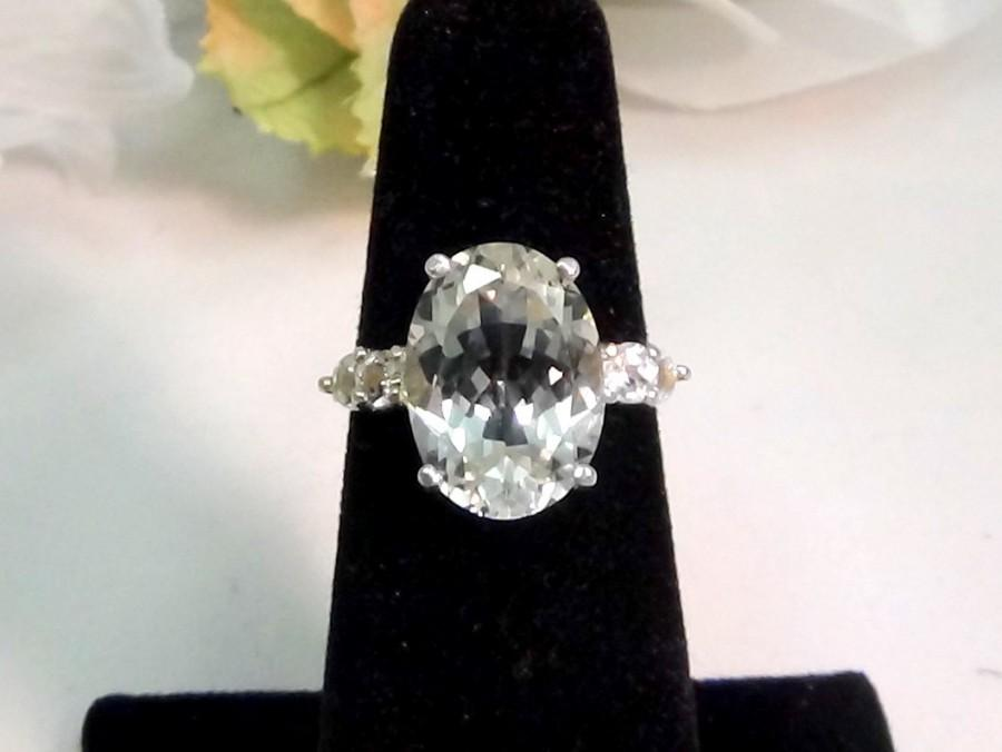 Hochzeit - Incredible white topaz gemstone, 14x10 oval, surrounded by four white topaz accents in silver. Gorgeous ring from brazil. Select size.