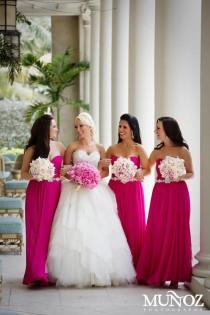 wedding photo - Bride with the bride's maid wearing a hot pink colored gown.