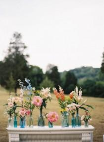 wedding photo - Rustic Florals In Mismatched Vases