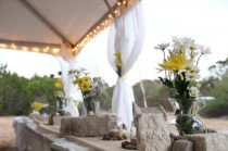 wedding photo - Rustic Flower and Stone Arrangements as Table Centerpieces