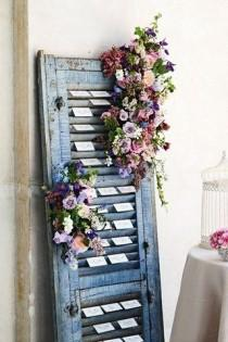 wedding photo - Escort Card Display Idea; Rustic Themed Wedding (BridesMagazine.co.uk)