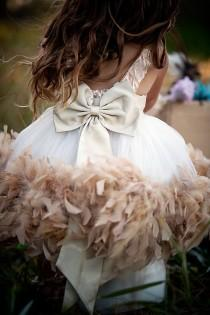 wedding photo - Demure Elegance... A Satin Rosette Feather Dress